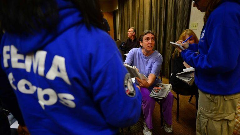 Lori Stein, 56, of Long Beach talks to
