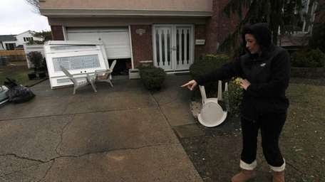 Lisa Sileo points at her driveway which has