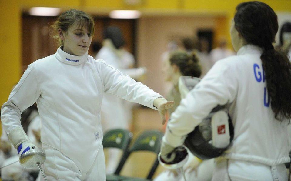 Ward Melville's Kirsten Shaw, left, wins her match