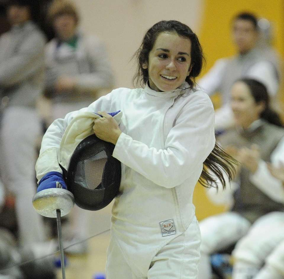 Ward Melville's Arianna Ferretti reacts after she wins