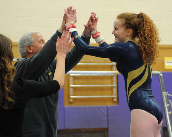 Massapequa's Katie Wall, right, gets congratulatory high fives