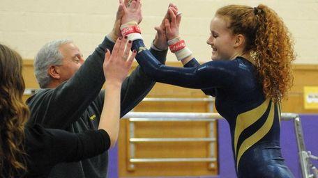 Massapequa's Katie Wall, right, gets congratulatory high fives
