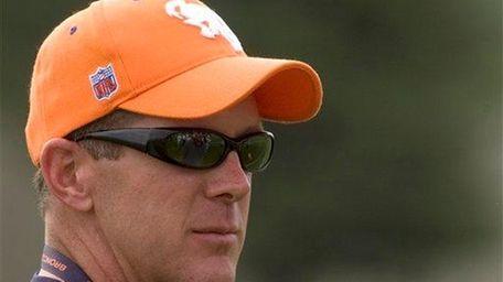 Denver Broncos general manager Ted Sundquist looks on