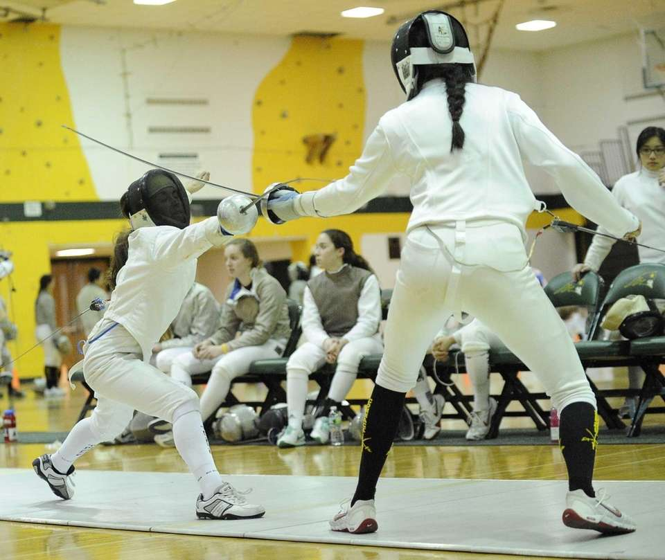 Ward Melville's Arianna Ferretti, left, competes in an
