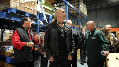 Long Island musician Dee Snider, center, takes a