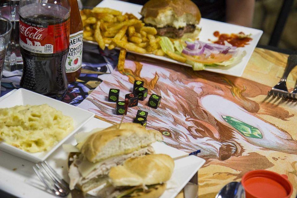 Zombie Dice lie on the table around various