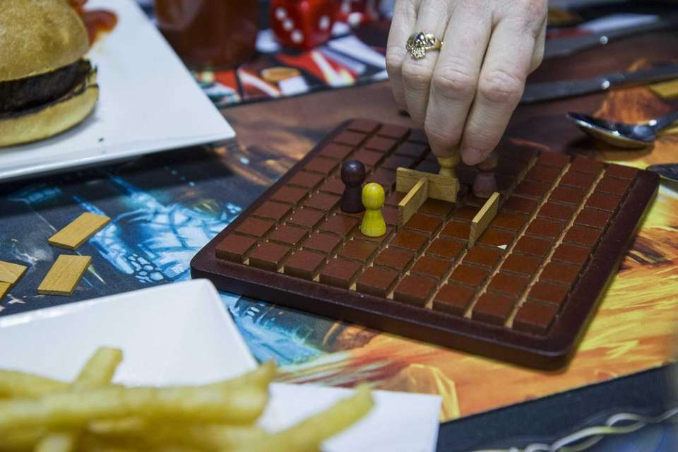 Quoridor is being played at Game Master Grill