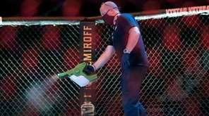 A worker sprays sanitizer in the octagon between