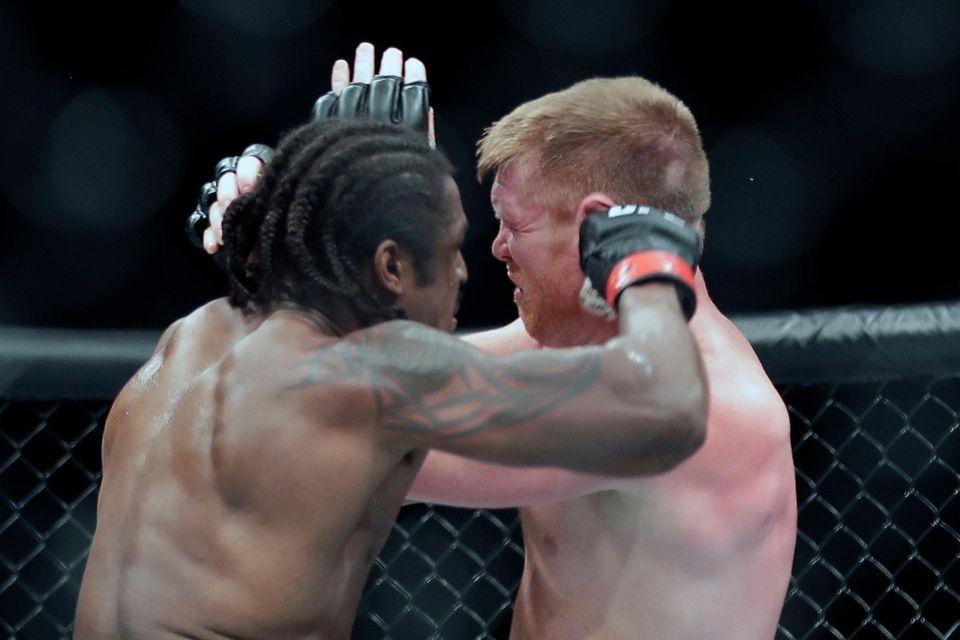 Sam Alvey, right, fights Ryan Spann during a