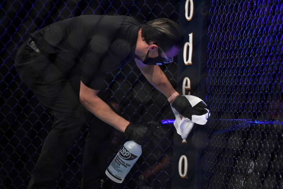 Staff members clean the cage of the octagon