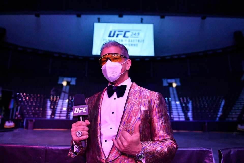 UFC Octagon announcer Bruce Buffer poses with a