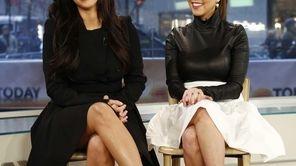 From left, Kim Kardashian and Kourtney Kardashian appear