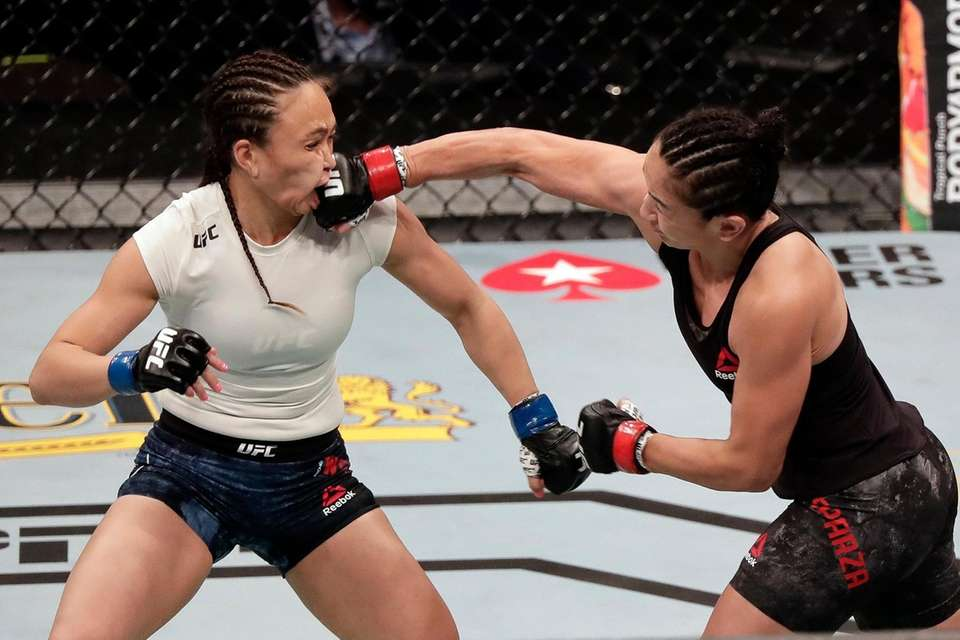 Carla Esparza, right, lands a punch on Michelle