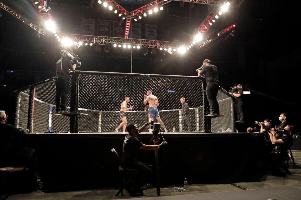 Anthony Pettis, center left, and Donald Cerrone fight