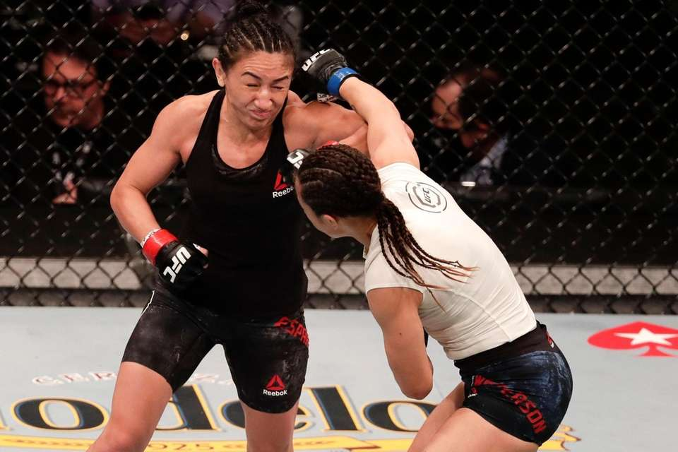 Carla Esparza, left, fights Michelle Waterson during a