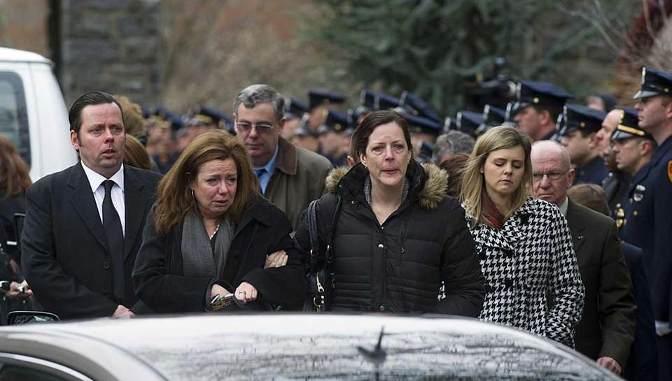 Family and loved ones leave St. Patrick Church