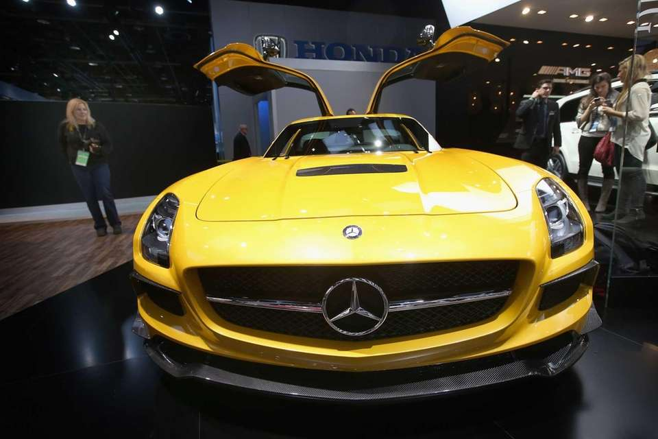 Visitors look over a Mercedes SCG AMG Black