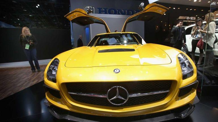 Visitors look over a Mercedes SCG AMG Black