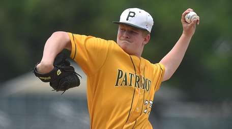 Ryan Hynes of Ward Melville delivers on Saturday,