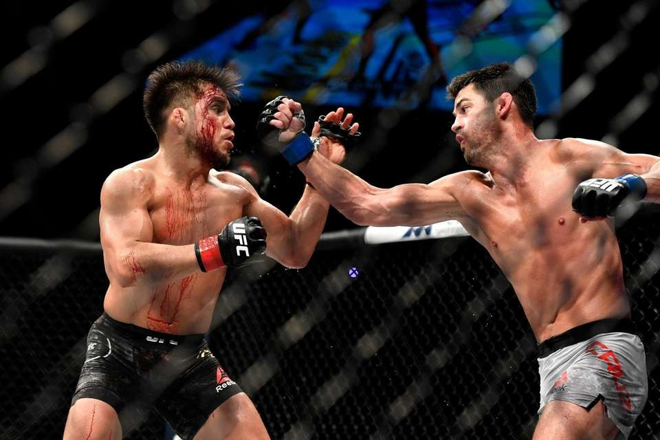 Henry Cejudo (L) of the United States fights