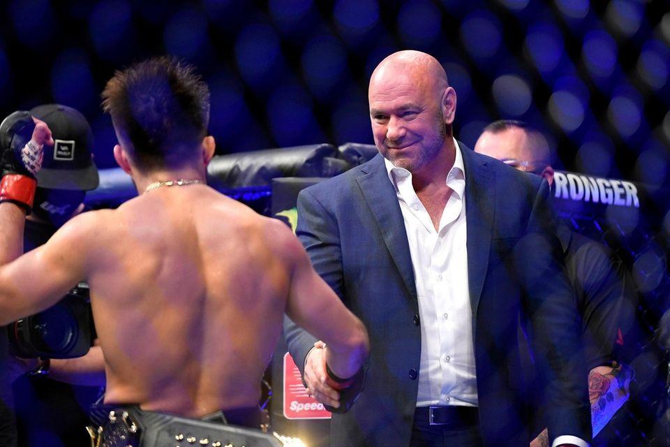 UFC President Dana White (R) congratulates Henry Cejudo