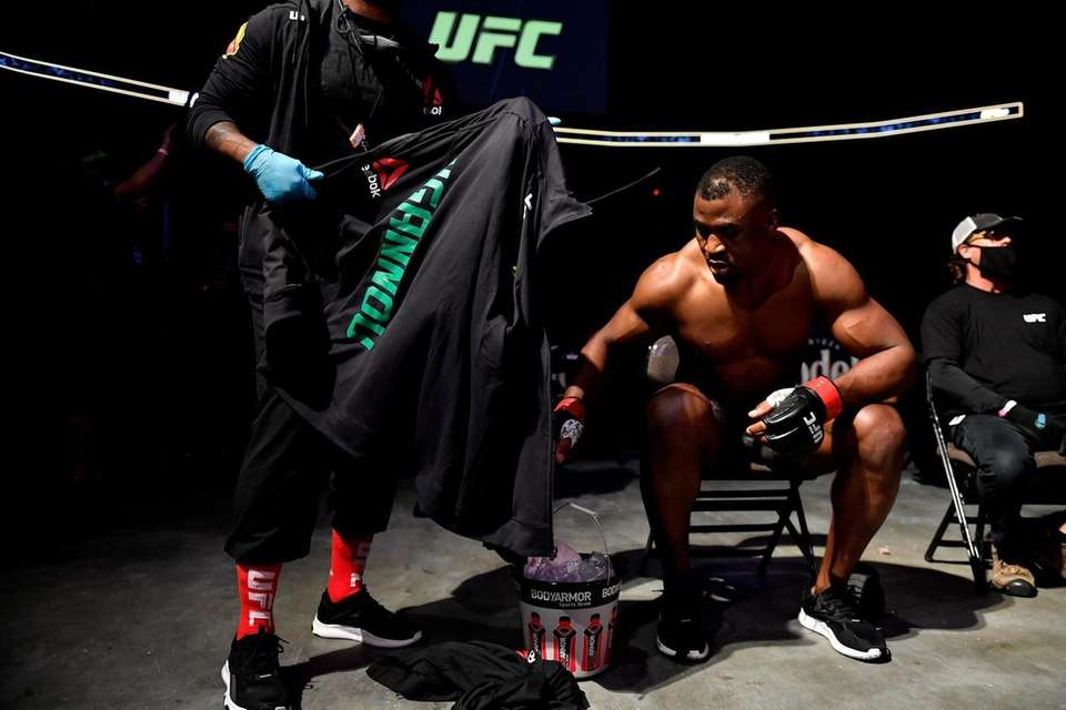 Francis Ngannou of Cameroon sits down after his