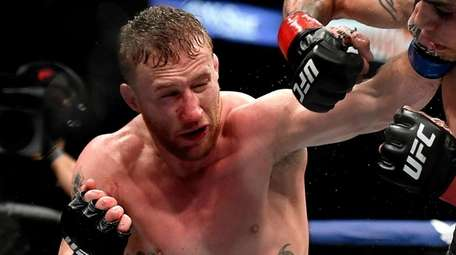 Justin Gaethje, left, punches Tony Ferguson in their