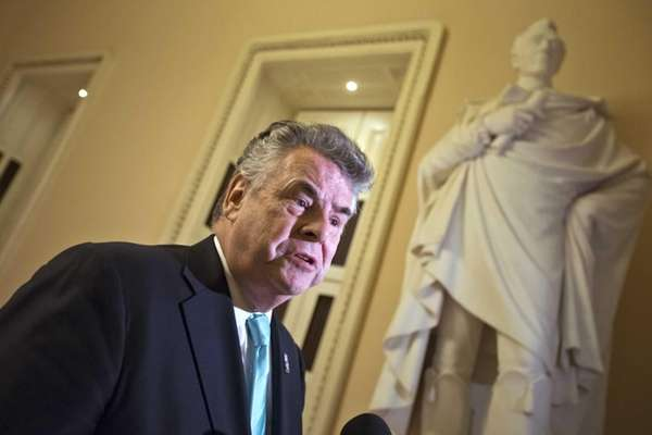 Rep. Peter King speaks to reporters after appearing