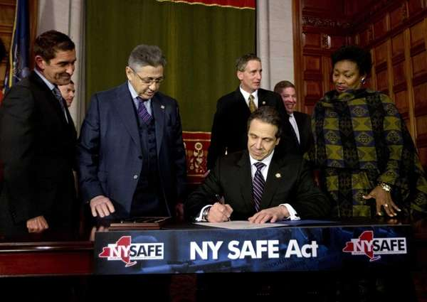 New York Gov. Andrew Cuomo signs New York's