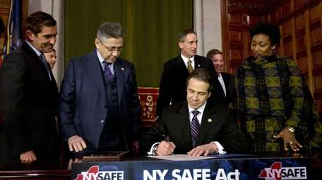 New York Gov. Andrew Cuomo signs New York's