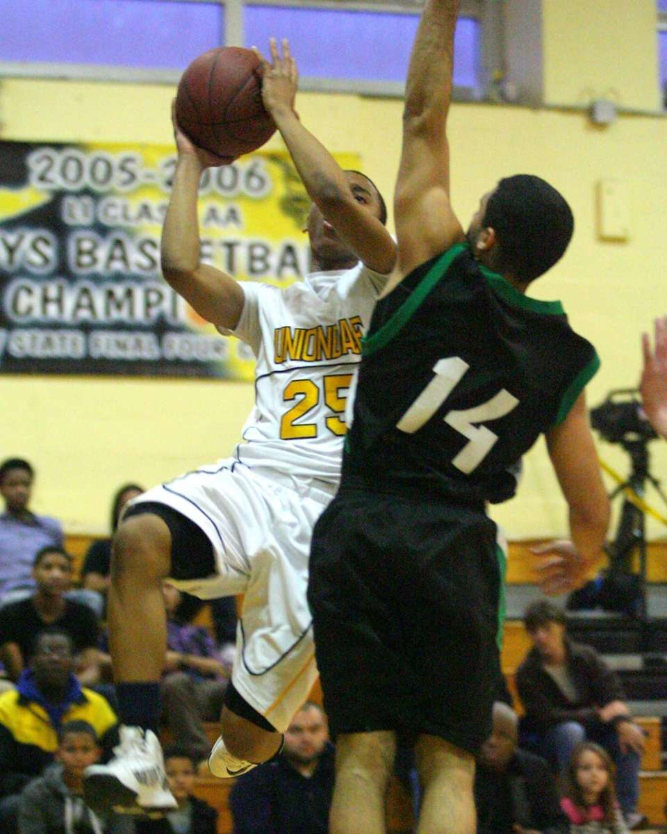Uniondale's Aaron Cust #25 attempts to shoot around