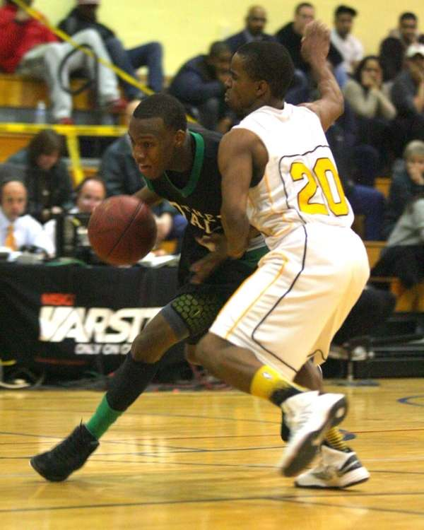 Farmingdale's Dalique Mingo #4 drives hard around Uniondale's