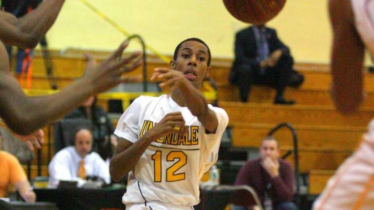 Uniondale's Imran Ritchie passes the ball early in