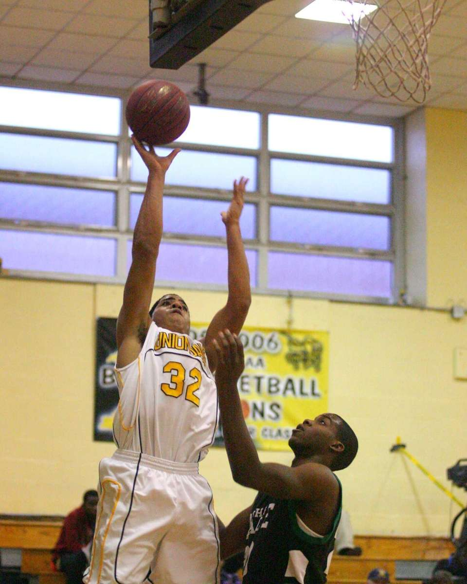 Uniondale's Nick Danns #32 puts a shot over