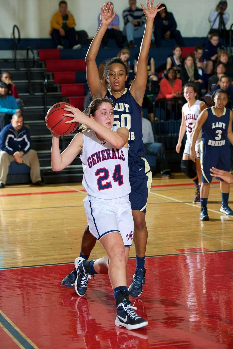 MacArthur junior Stephanie Volpe is tightly guarded under