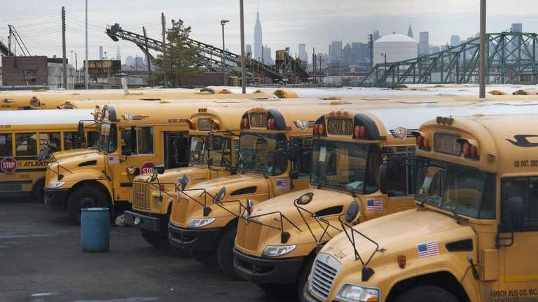 Atlantic Express school buses are lined up in
