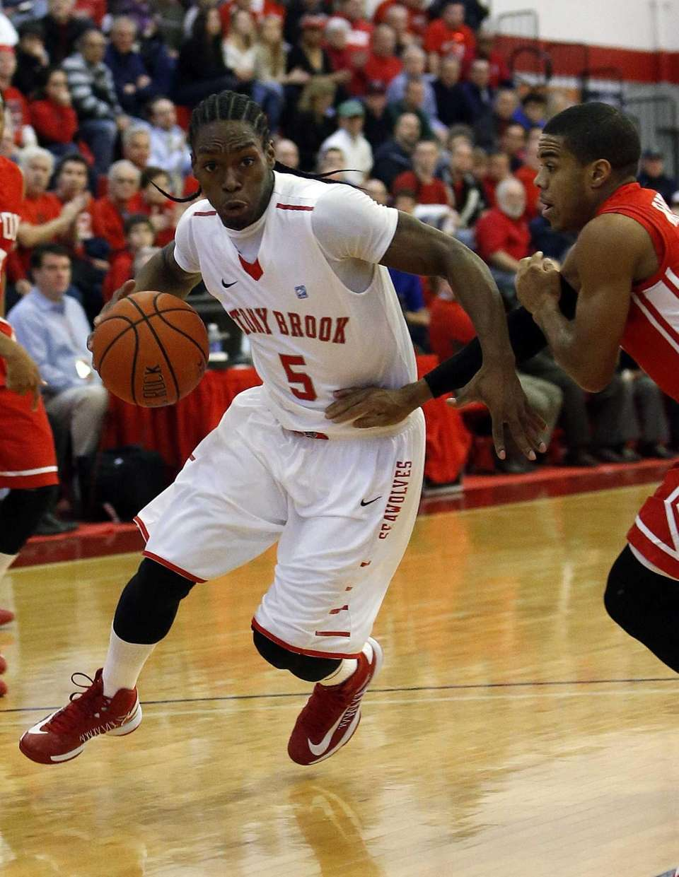Stony Brook's Dave Coley drives against Boston's Maurice