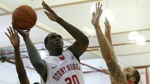 Stony Brook's Jameel Warney goes for the layup