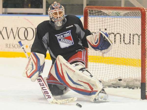 Henrik Lundqvist makes a save during training camp