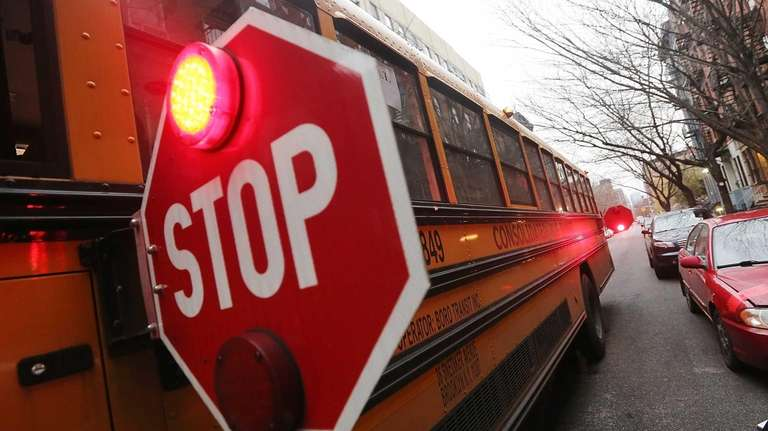 A school bus stops while picking up a