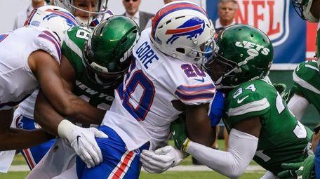 New York Jets cornerback Brian Poole  stops