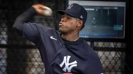 Yankees pitcher Luis Severino throws in the bullpen