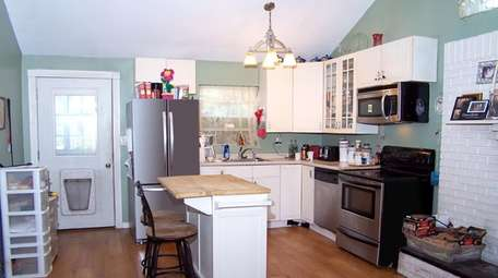 The kitchen comes with stainless steel appliances.