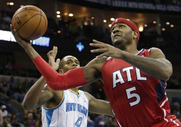 Atlanta Hawks small forward Josh Smith shoots past
