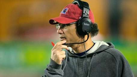 Montreal Alouettes head coach Marc Trestman talks into