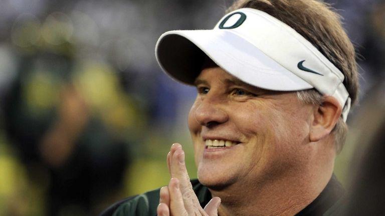 Ex-Oregon head coach Chip Kelly waits before the