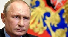 Russian President Vladimir Putin attends a meeting on