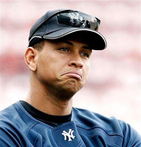 Alex Rodriguez stands in the infield before a