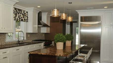The renovated kitchen is shown inside an Oyster