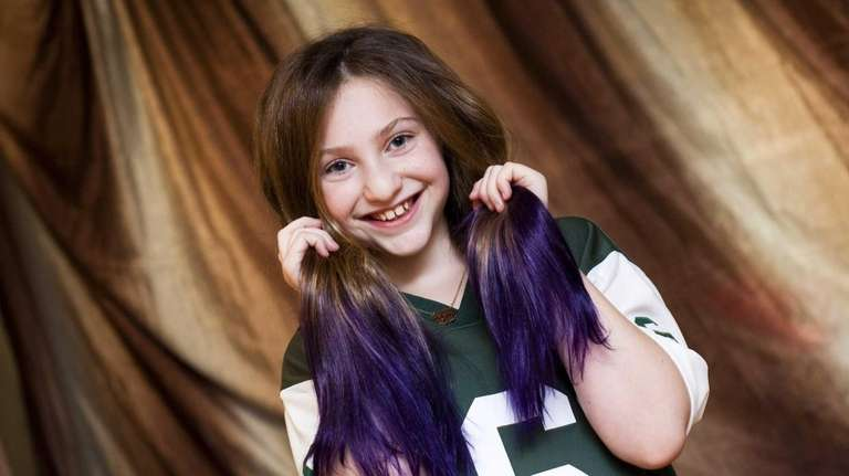 Sydney Resnick, 10, of East Northport, poses with